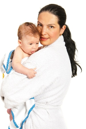 Happy mother and her baby son in bathrobes after bath isolated on white background photo