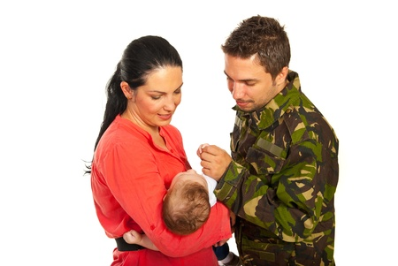 Military father came home and meeting his newborn baby son isolated on white background photo