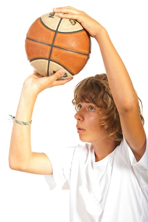 boy ball: Closeup of teen boy throwing basketball isolated on white background