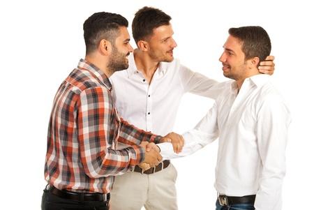 congratulate: Two executives men congratulate their coleague isolated on white background