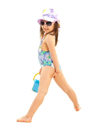 child swimsuit: Cute little girl in swimsuit ,sunglasses and sun hat posing isolated on white background