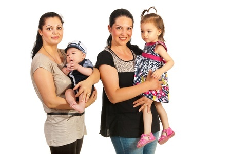 mothers group: Two mothers holding each a child isolated on white background