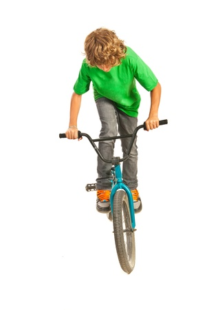 stunts: Teen boy trying a stunt on bike isolated on white background
