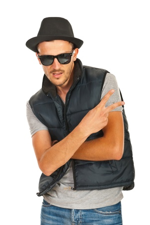 Trendy rapper with hat and sunglasses gesturing isolated on white background photo