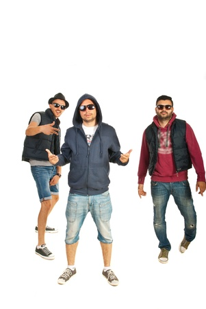 Group of three break dancers performing isolated on white background photo