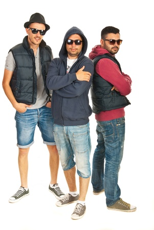 Gropu of three rappers male with sunglasses isolated on white background photo
