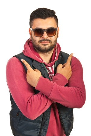 Young rapper man wearing sunglasses and getsuring isolated on white background photo