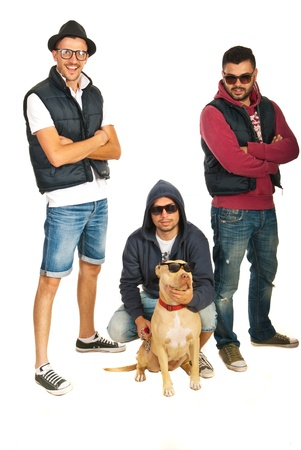 Funky hip hop members with pitbull dog isolated on white background photo