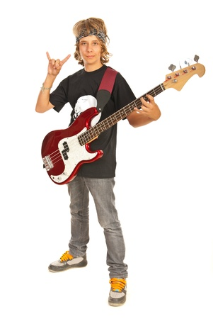 Rocker teenager boy with bass guitar gesturing isolated on white background photo