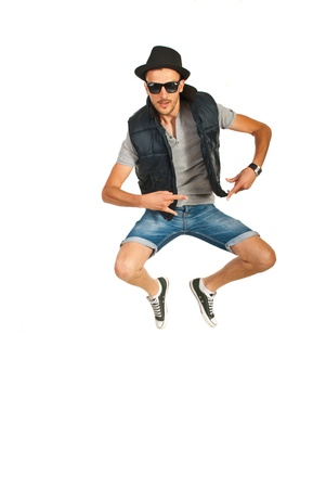 Jumping break dancer man with hat isolated on white background photo