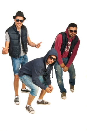 Dancing three rappers guys isolated on white background photo