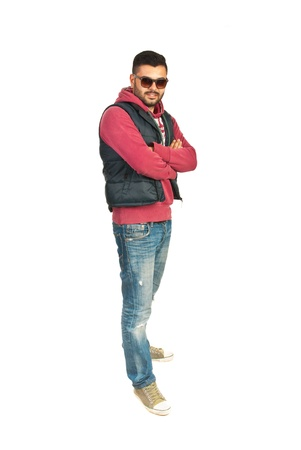 street shots: Full length of rapper man standing with arms folded isolated on white background Stock Photo
