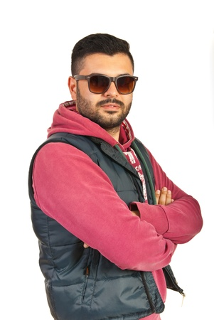 Rapper man posing with arms folded isolated on white background photo