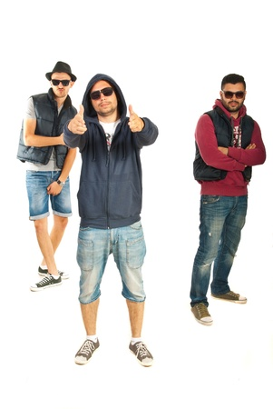Three men rappers gesticulate isolated on white background photo