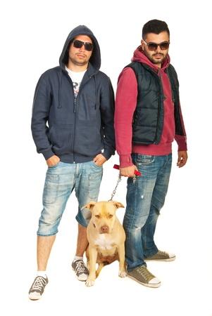 Bad boys with pitbull isolated on white background photo