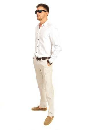 white pants: Elegant man with sunglasses looking away isolated on white background Stock Photo