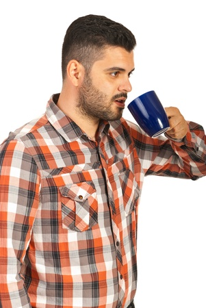 Business man in profile drinking cofee isolatedon white background photo