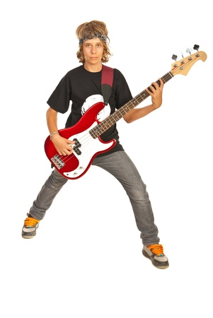 bassist: Rocker teen boy with bass guitar isolated on white background