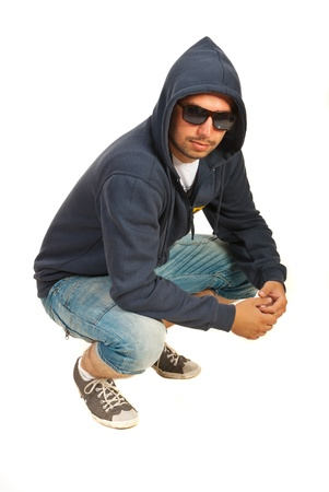 hip hop man: Hooded hip hop man posingisolated on white background Stock Photo