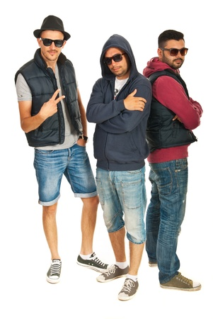 street shots: Group of three hip hop dancers with sunglasses isolated on white background