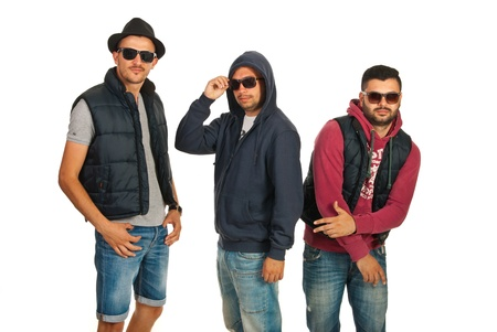 Dancing group of three men with sunglasses isolated on white background photo