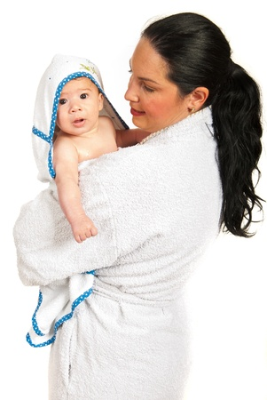 looking after: Mother and her baby boy in bathrobes after bath isolated on white background Stock Photo
