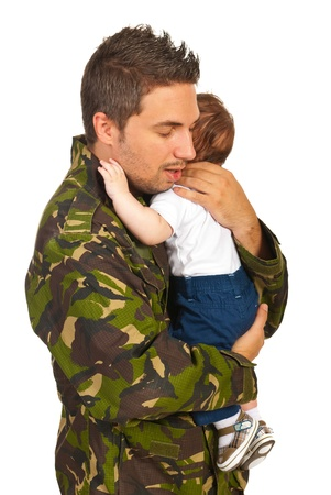 homecoming: Military dad hugging his newborn baby son isolated on white background Stock Photo