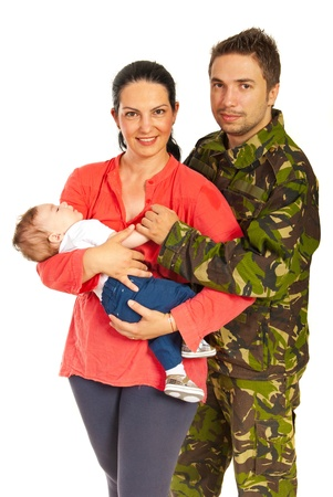 Military man and his family standing in embrace isolated on white background photo