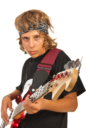 Teen boy playing bass guitar isolated on white background photo