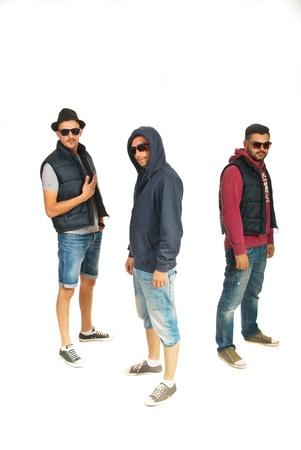 raperos: Grupo de tres hombres raperos con gafas de sol aislados sobre fondo blanco Foto de archivo