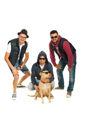 rappers band with pitbull dog with sunglasses isolated on white background photo