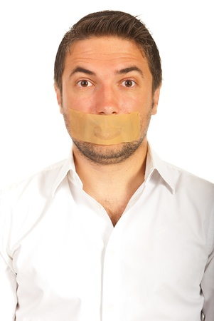 Portrait of man with duct tape over mouth isolated on white background photo
