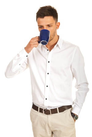Casual business man drinking coffee isolated on white background photo