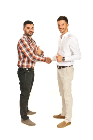 Business men giving hand shake and showing thumbs isolated on white background photo