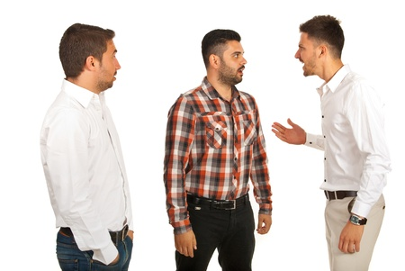 Business man yelling at his colleague and other man being surprised isolated on white background photo