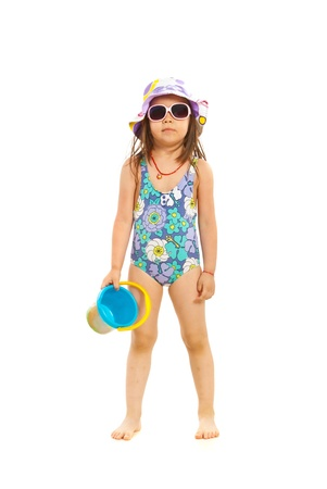 child swimsuit: Preschooler girl ready for beach isolated on white background