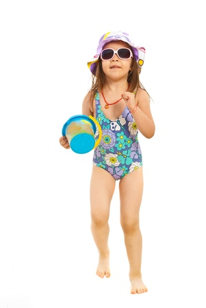 child swimsuit: Running beach girl holding bucket isolated on white background