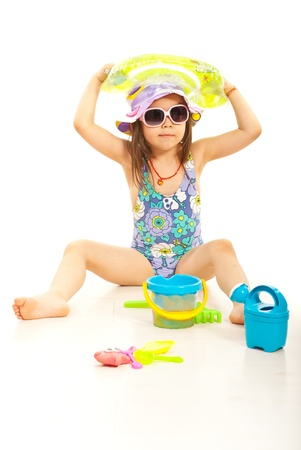 child swimsuit: Cute beach girl with sunglasses and toys against white Stock Photo