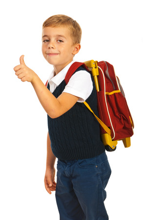 schoolbag: Schoolchild giving thumb up isolated on white
