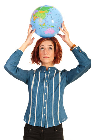 Executive woman holding world globe overhead and looking up isolated on white  photo