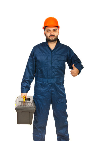 constructors: Successful electrician man giving thumb up isolated on white
