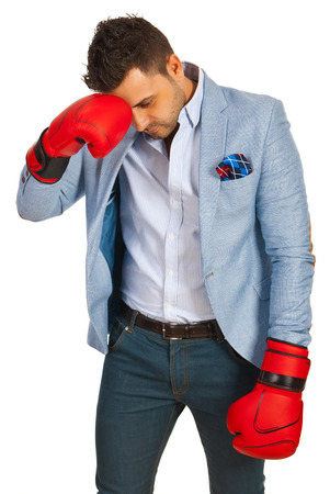 Stressed business man with boxing gloves loss competition isolated on white  photo