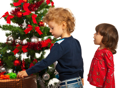 amazed girl and boy decorate christmas tree stock photo 22650219