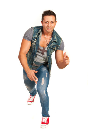 Dancing man in jeans clothes isolated on white background photo