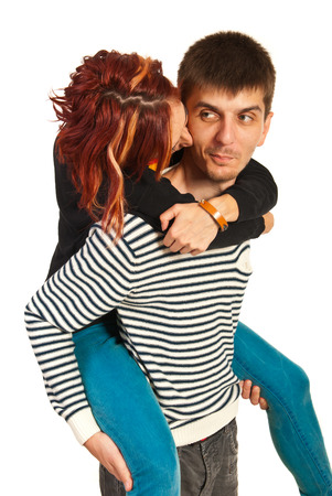 Woman kissing funny man in piggy back isolated on white  photo