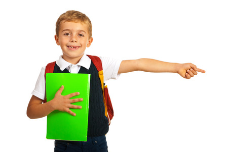 Schoolboy pointing to right part of image isolated on white background 版權商用圖片