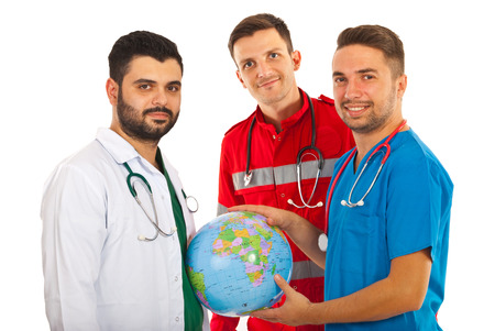 Different doctors holding world globe isolated on white background photo