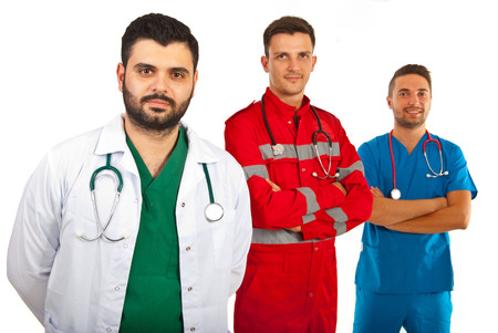 Happy team of three different doctors males isolated on hwite background photo
