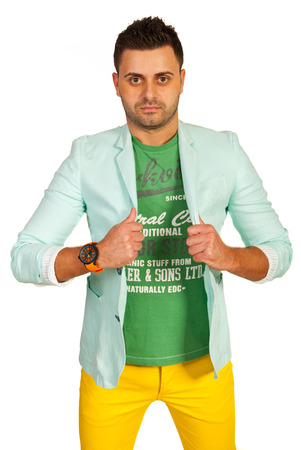 manin: Model manin green jacket and yellow pants isolated on white background