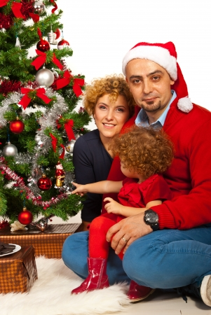 Cheerful happy family standing near Christmas tree photo